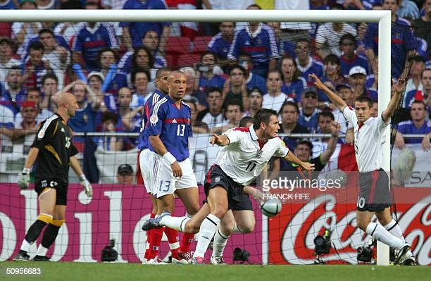 England midfielder Frank Lampard raises his arms after scoring against France 13 June 2004 during their opening match at the European Nations...