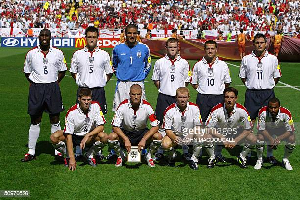 England's national football team players pose 17 June 2004 at Coimbra stadium before their Euro 2004 group B football match against Switzerland at...