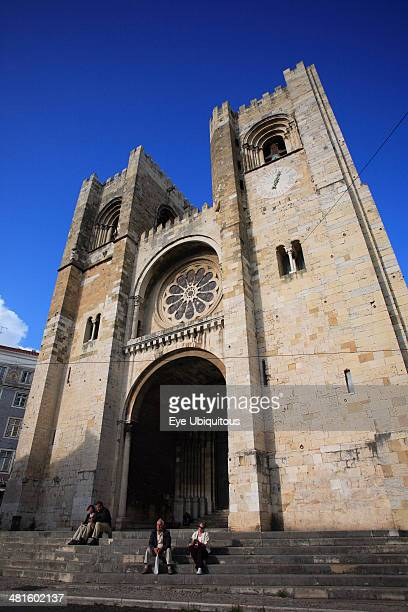 Portugal Estremadura Lisbon Se Cathedral exterior facade with visitors on steps to entrance
