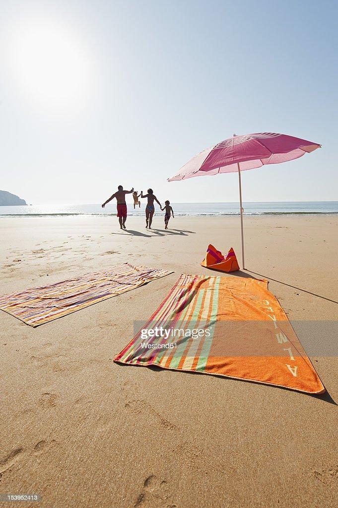 Portugal, Family running on beach : ストックフォト