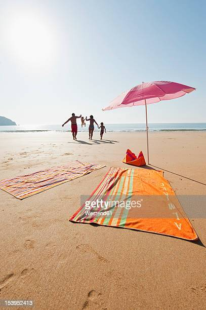 portugal, family running on beach - sagres stock pictures, royalty-free photos & images