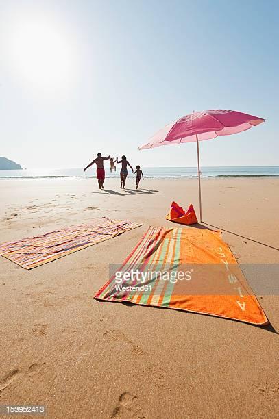 Portugal, Family running on beach