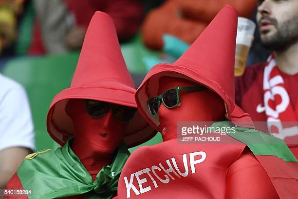 Portugal fan dressed up as 'ketchup' bottles in the colours of Portugal wait for the start of the Euro 2016 group F football match between Portugal...