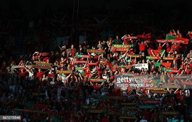 Portugal fans hold scarves during the Euro 2016 group F football match between Portugal and Austria at the Parc des Princes in Paris on June 18,...