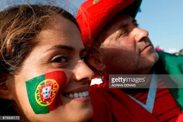 TOPSHOT Portugal fans pose for a photo outside the Fisht Stadium in Sochi on June 15 ahead of the game between Portugal and Spain during the Russia...