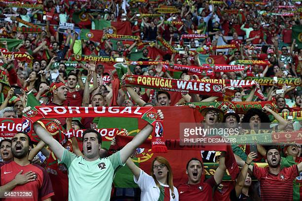 Portugal fans wait for the start of the Euro 2016 semifinal football match between Portugal and Wales at the Parc Olympique Lyonnais stadium in...