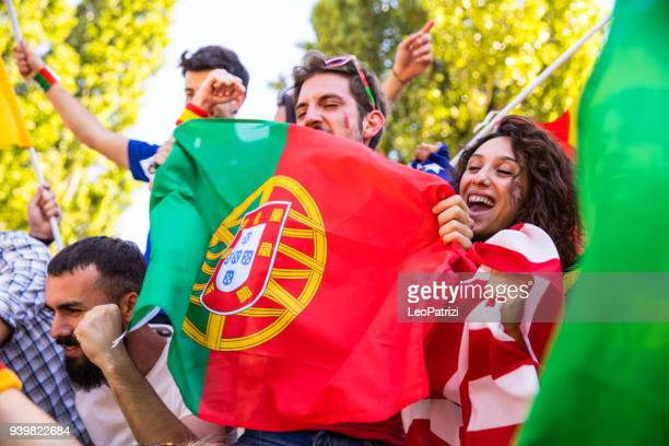 Portugal fans watching and supporting their team at world competition football league