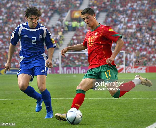 File picture showing Greece's defender Georgios Seitaridis fighting for the ball with Portugal's forward Cristiano Ronaldo 12 June 2004 at Dragao...