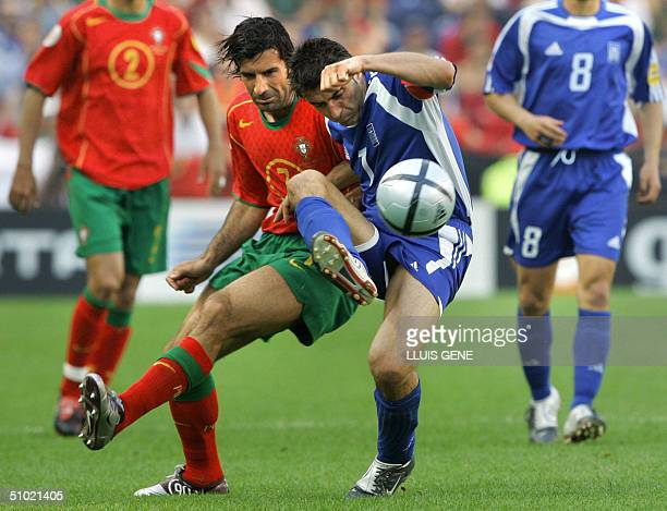 File picture showing Portugal's forward Luis Figo fighting for the ball with Greece's midfielder Theodoros Zagorakis 12 June 2004 at Dragao stadium...