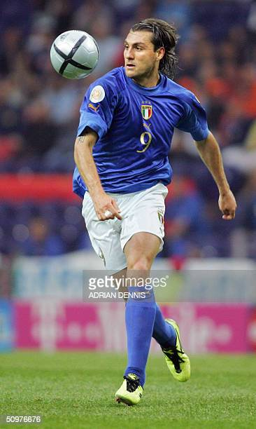 FOLLOW UP ON SWEDEN ITALY EURO 2004 MATCH Italy's forward Christian Vieri breaks away with the ball 18 June 2004 during their European Nations...