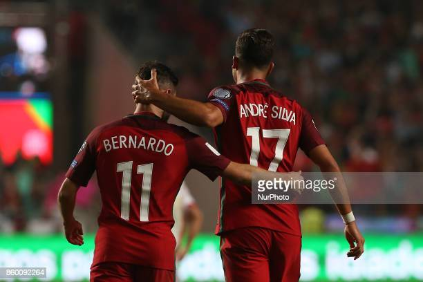 Portugal forward Andre Silva celebrating with Portugal midfielder Bernardo Silva after scoring a goal during the match between Portugal v Switzerland...