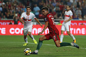 portugal forward andre silva kicking goal