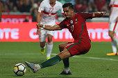 portugal forward andre silva kicking goal