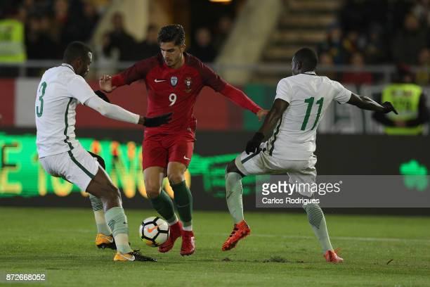 Portugal forward Andre Silva vies with Saudi Arabia defender Osama Hawsawi and Saudi Arabia midfielder Abdulmalek Al Khaibri for the ball possession...