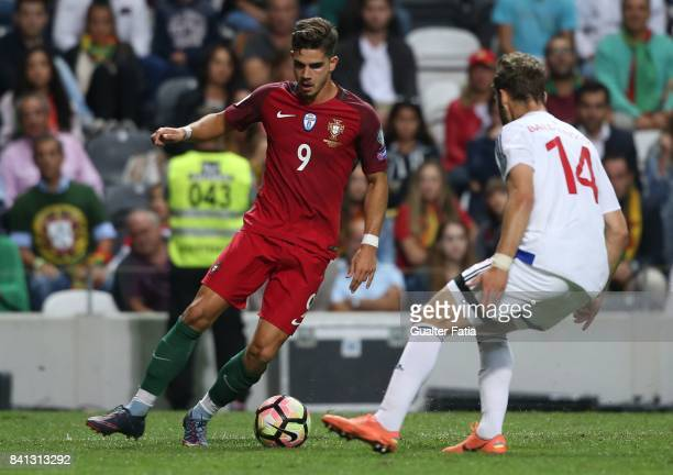Portugal forward Andre Silva with Faroe Island defender Rogvi Baldvinsson in action during the FIFA 2018 World Cup Qualifier match between Portugal...
