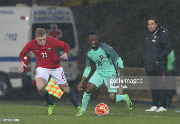 Portugal forward Carlos Mane with Henrik Bjordal of Norway in action during the U21 International Friendly match between Portugal and Norway at...