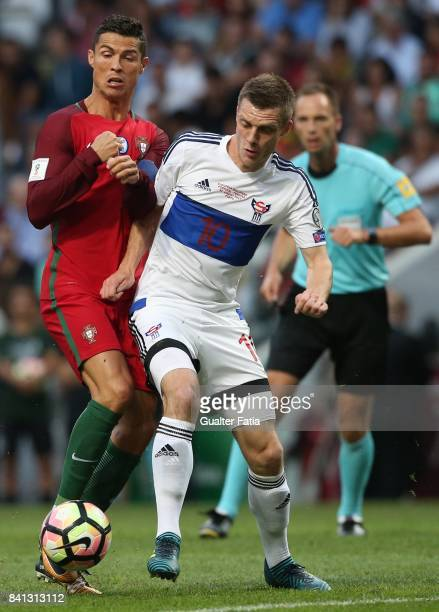 Portugal forward Cristiano Ronaldo with Faroe Island midfielder Solvi Vanhamar in action during the FIFA 2018 World Cup Qualifier match between...