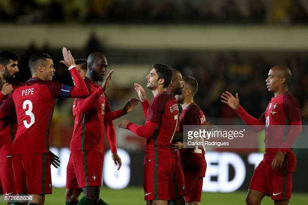 Portugal forward Goncalo Guedes celebrates scoring Portugal second goal with his team mates during the match between Portugal and Saudi Arabia...