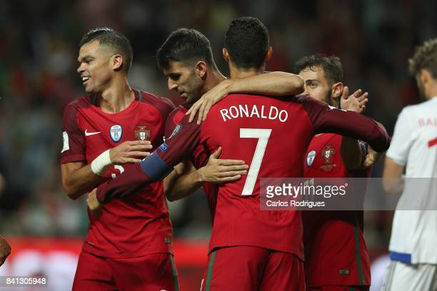 Portugal forward Nelson Oliveira celebrates scoring Portugal fifth goal with Portugal forward Cristiano Ronaldo during the match between Portugal v...