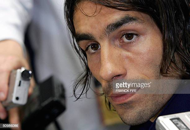 French midfielder Robert Pires answers journalists' questions during a press conference 22 June 2004 in Santo Tirso during the European Nations...