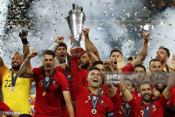 Portugal goalkeeper Beto Jose Fonte of Portugal Danilo of Portugal Cristiano Ronaldo of Portugal with the Nations League trophy Raphael Guerreiro of...