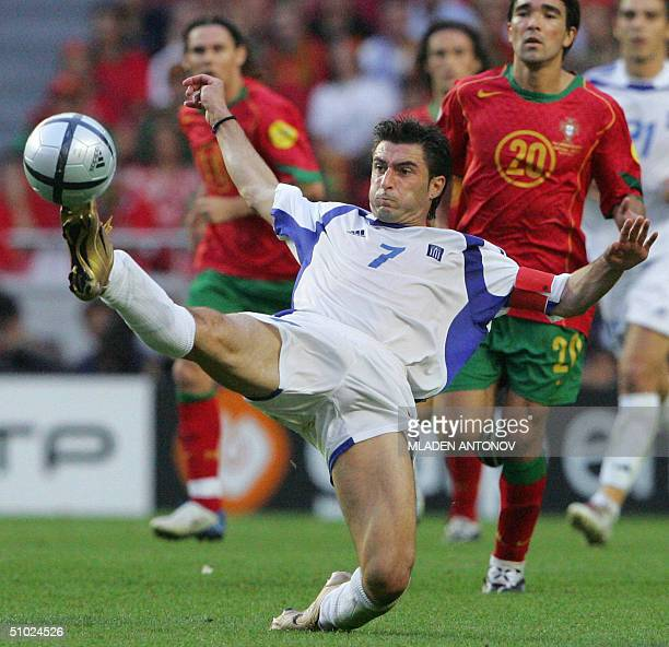 Greece's captain Theodoros Zagorakis hooks the ball away 04 july 2004 at the Stadio Da Luz in Lisbon during the Euro 2004 final match between...