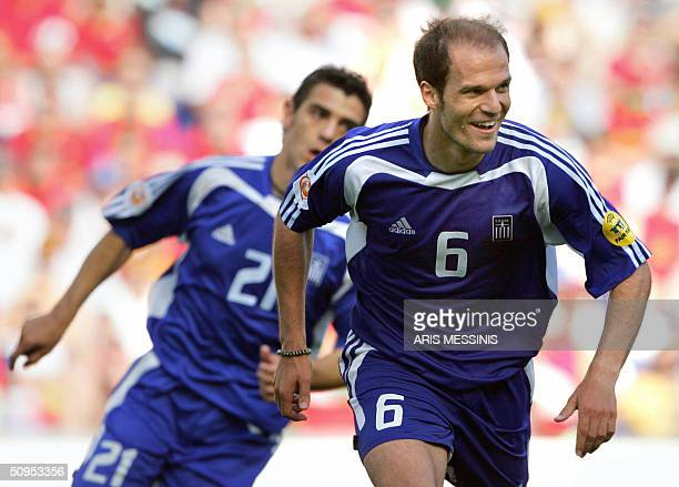 Greece's midfielder Angelis Basinas celebrates after scoring the second goal for his team12 June 2004 at Dragao stadium in Porto during the Euro 2004...