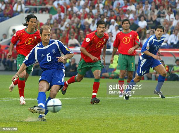 Greece's midfielder Angelis Basinas kicks the ball to score 12 June 2004 at Dragao stadium in Porto during the Euro 2004 group A football match...