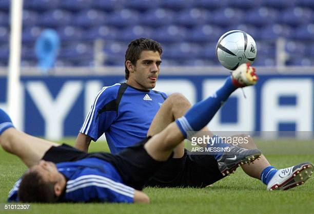 Greece's midfielder Kostas Katsouranis plays with the ball during a training session at Dragao stadium in Porto 30 June 2004 one day before their...