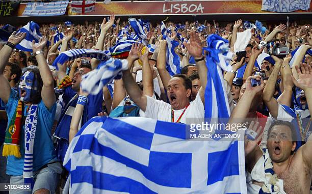 Greek fans celebrate 04 july 2004 at the Stadio Da Luz in Lisbon after the Euro 2004 final match between Portugal and Greece at the European Nations...