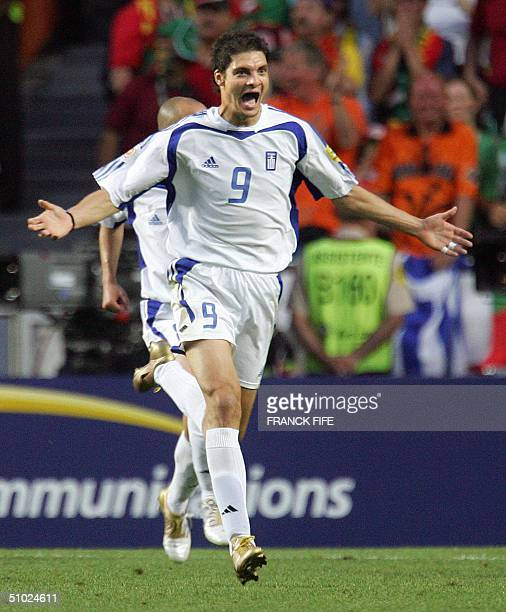 Greek forward Angelos Charisteas celebrates his opening goal 04 July 2004 at the Luz stadium in Lisbon during the Euro 2004 final match between...