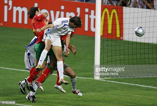 Greek forward Angelos Charisteas heads the ball to score the opening goal 04 July 2004 at the Estadio da Luz in Lisbon during the European Nations...