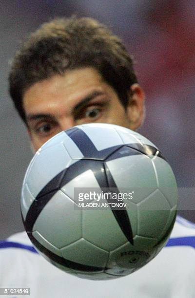 Greek forward Angelos Charisteas stare at the ball 04 july 2004 at the Stadio Da Luz in Lisbon during the Euro 2004 final match between Portugal and...