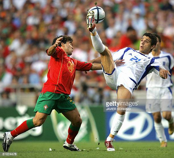 Greek midfielder Konstantinos Katsouranis controls the ball next to Portuguese midfielder Deco 04 July 2004 at the Luz stadium in Lisbon during the...
