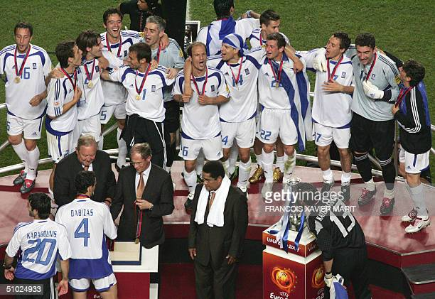 Greek players receive their medals and celebrate on the podium 04 July 2004 at Stadio da Luz in Lisbon after the Euro 2004 final football match...