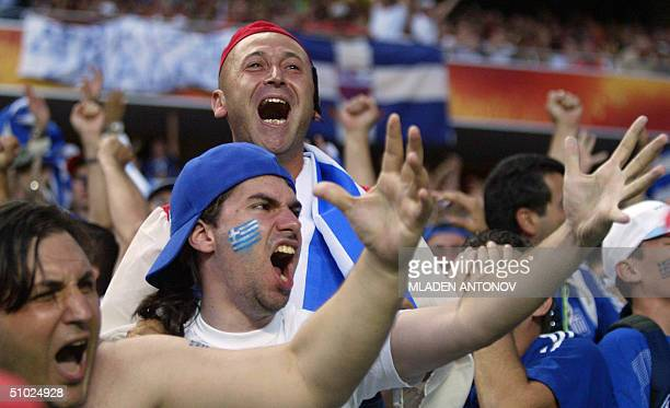 Greek supporters celebrate 04 july 2004 at the Stadio Da Luz in Lisbon after the Euro 2004 final match between Portugal and Greece at the European...