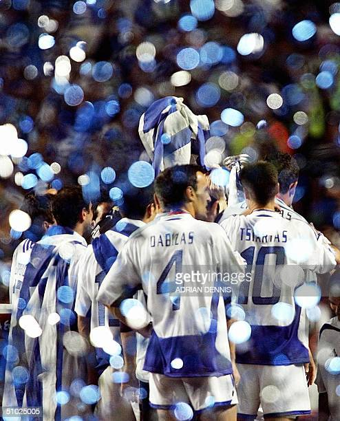 Grrek players are seen as blue and white confettis fly around 04 July 2004 at the Luz stadium in Lisbon after the Euro 2004 final match between...