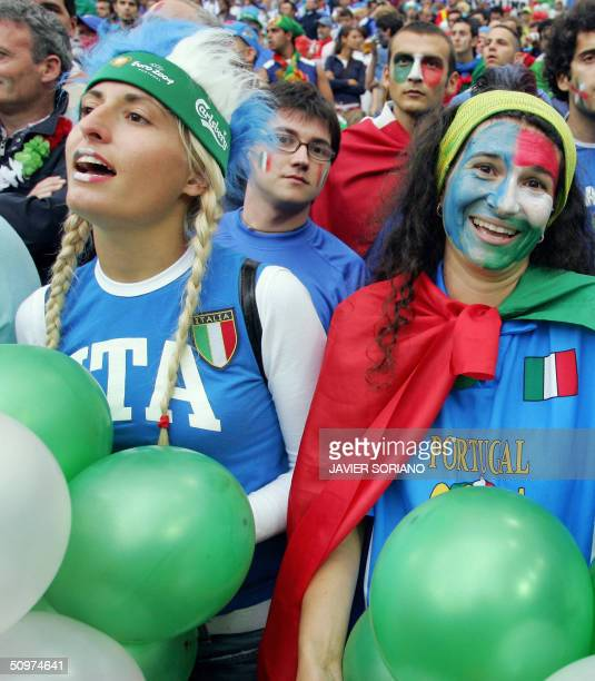 Italian fans cheer on their team 18 June 2004 before their Euro 2004 Group C football match against Sweden at the Dragao stadium in Porto AFP PHOTO...