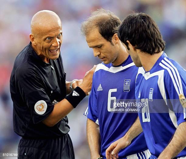 Italian referee Pierluigi Collina talks to Greece's midfielder Angelis Basinas 01 July 2004 at Dragao stadium in Porto during the Euro 2004 semifinal...