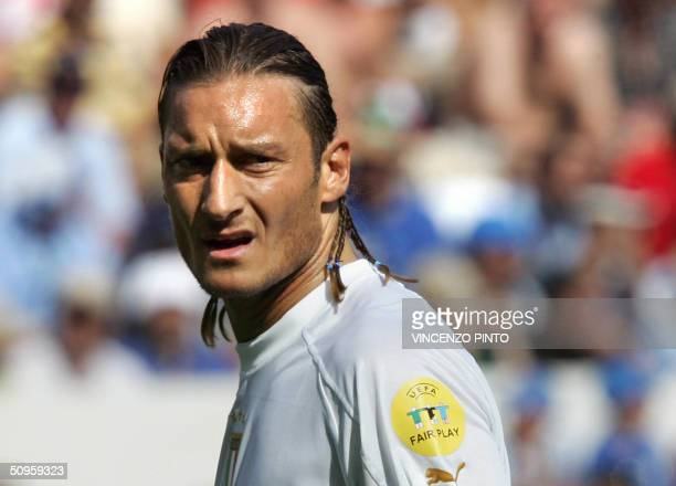 Italy's forward Francesco Totti reacts 14 June 2004 at Henriques stadium in Guimaraes during his team's Euro 2004 group C football match against...