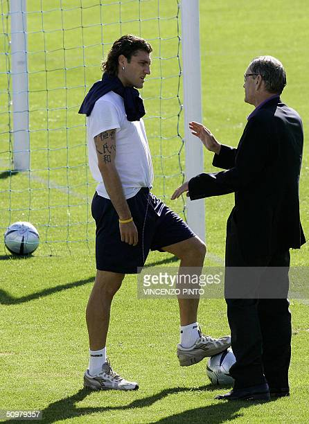 Italy's striker Christian Vieri talks with team manager Gigi Riva as his teammate Mauro German Camoranesi plays as goalkeeper during a session...