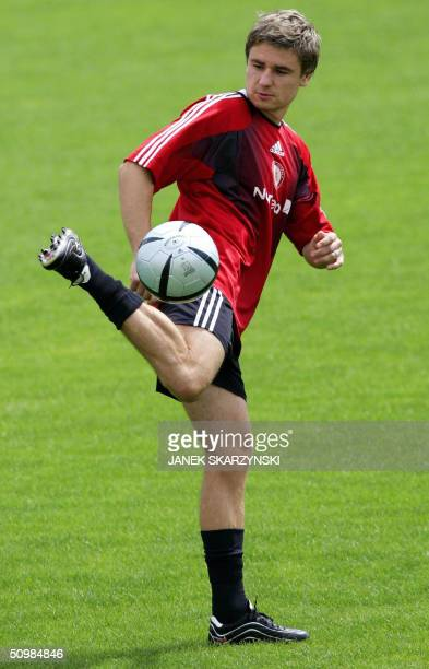 Latvian forward Marians Pahars plays with a ball during a training session in Anadia 22 June 2004 on the eve of their final game against The...