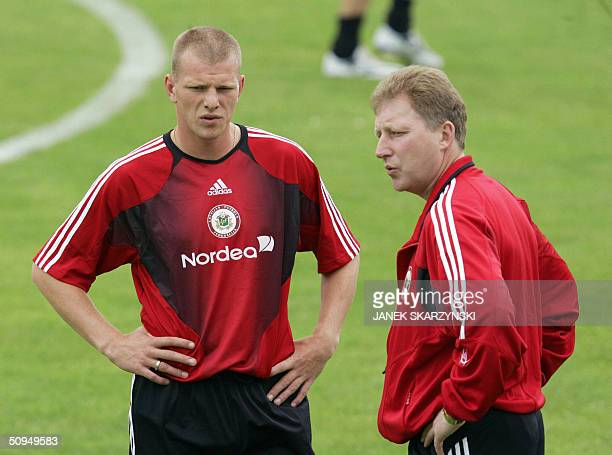 Latvian player Andrejs Prohorenkovs speaks with head coach Aleksandrs Starkovs during a training session with their team in Anadia 11 June 2004 in...