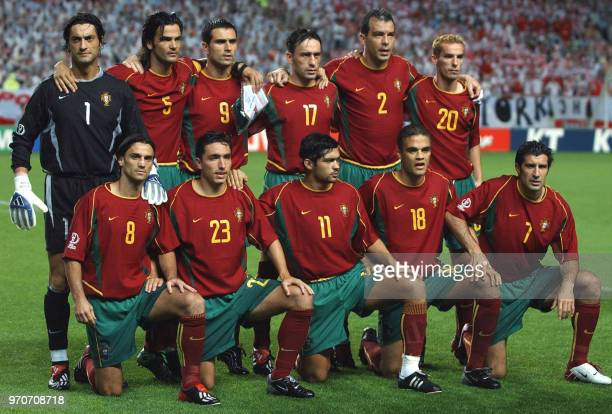 Portugal lineup for a team photo 10 June 2002 at the Jeonju World Cup Stadium in Jeonju ahead of the first round Group D match between Portugal and...