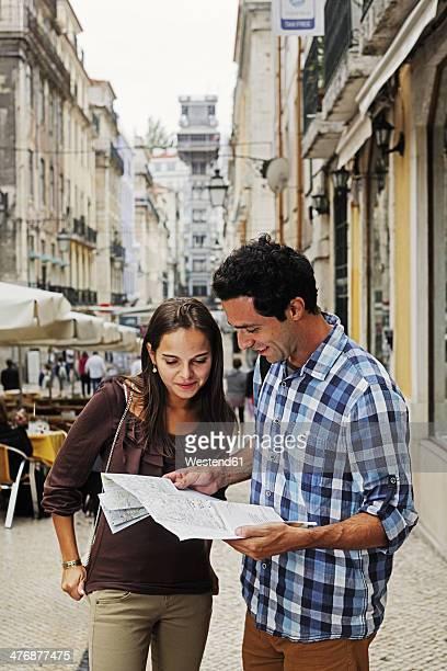 Portugal, Lisboa, Baixa, Rua Santa Justa, Elevador Santa Justa, young couple with city map