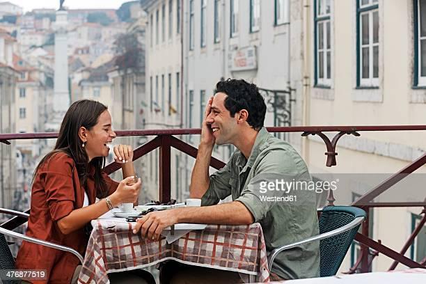 Portugal, Lisboa, Carmo, Largo du Duque, young couple sitting at street cafe