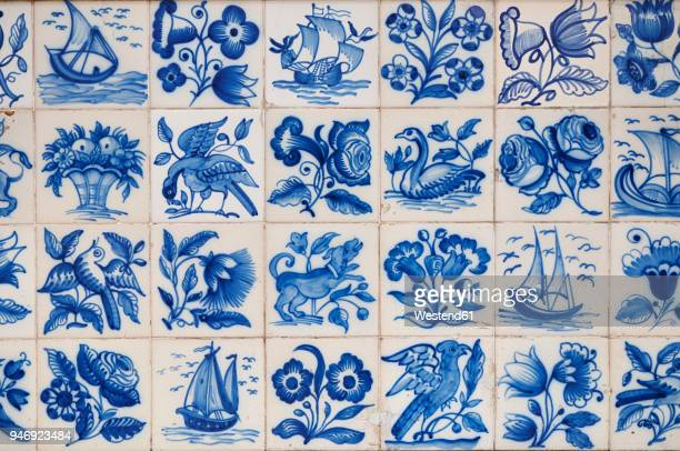 portugal, lisbon, alfama, part of wall with white and blue azulejos - cultura portoghese foto e immagini stock