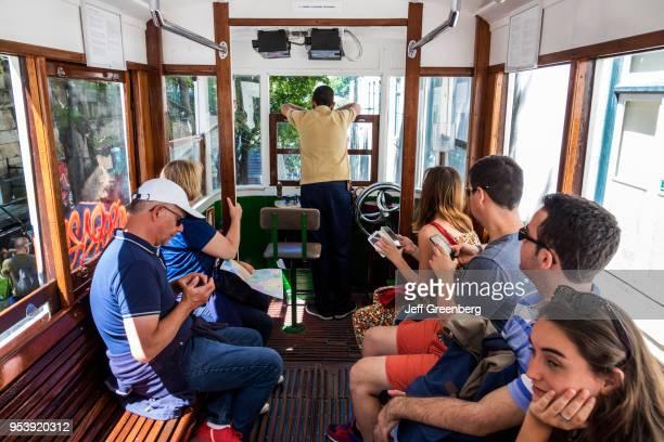 Portugal Lisbon Bairro Alto Elevador da Gloria passengers on funicular railway tram
