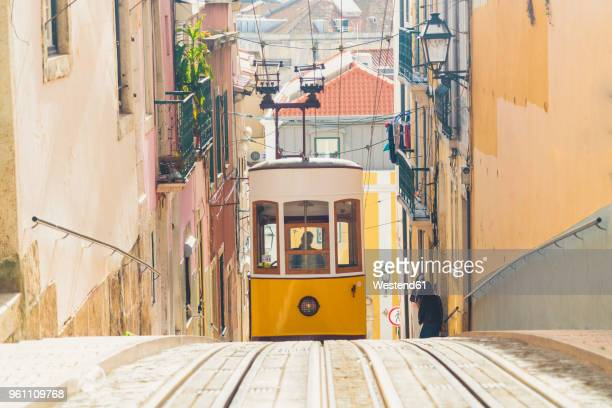 Portugal, Lisbon, Bairro Alto, Elevador da Gloria, yellow cable railways
