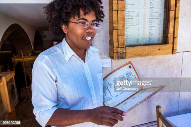 Portugal Lisbon Bairro Alto Restaurante Adega de Sao Roque restaurant worker with menu soliciting business